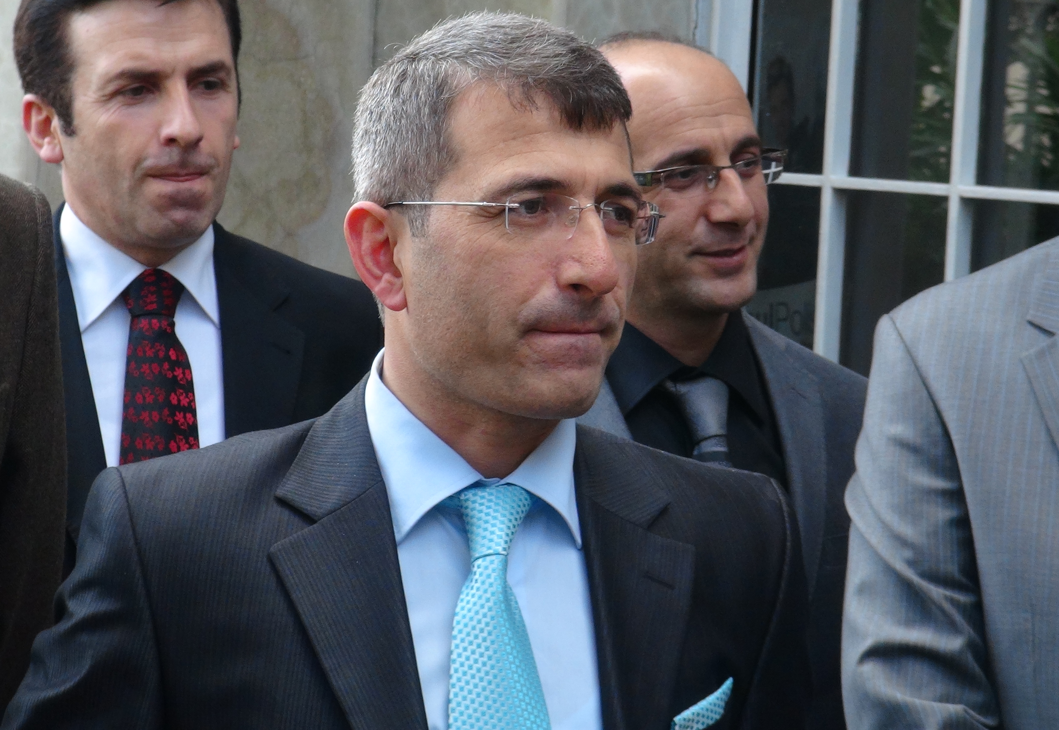 "This photo taken on December 26, 2013, shows Turkish prosecutor Muammer Akkas as he walks out from a courthouse in Istanbul. The Turkish prosecutor said today he had been prevented from expanding a corruption investigation that has touched the heart of the government, alleging pressure on the judiciary. ""All my colleagues and the public should be aware that I, as public prosecutor, have been prevented from launching an investigation,"" Muammer Akkas said in a statement. A high-level bribery and corruption investigation ensnaring former ministers and top businessmen has prompted a cabinet reshuffle by Prime Minister Recep Tayyip Erdogan, after three ministers stepped down in previous days. AFP PHOTO / CIHAN NEWS AGENCY / OSMAN ARSLAN ***TURKEY OUT*** (Photo credit should read Osman Arslan/AFP/Getty Images)"